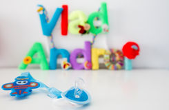 Blue pacifier on Vlad Andrei name background Stock Image
