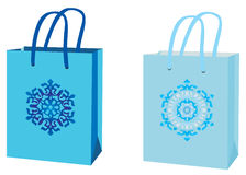 Blue packages with a snowflake Stock Photos