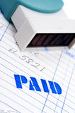 Blue paid stamp with an invoice on white Stock Photo