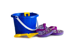 Blue pail and flip flops. Pail and shovel, along with child size flip flops, are perfect symbols that summer is here stock photography