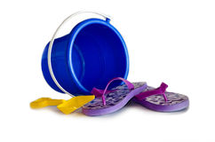 Blue pail and flip flops on white Royalty Free Stock Photo