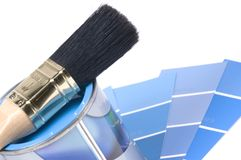 Blue paint. Can with blue paint and a paintbrush on top stock photos