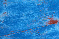 Blue paint. On wooden textured background Stock Images