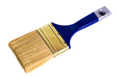 Blue paint brush lying on a white background Stock Images