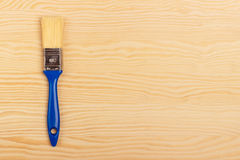 Blue paint brush on a wooden background Royalty Free Stock Photos