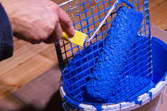Blue paint in a bucket Royalty Free Stock Photography