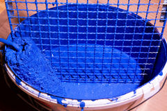 Blue paint in a bucket Royalty Free Stock Images