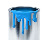 Blue paint dripping. Thick blue paint dripping tin can container on white background Stock Images