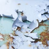 Blue paint flakes falling off Royalty Free Stock Photography