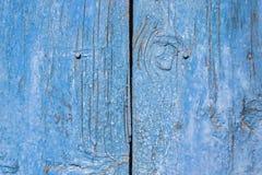 Blue paint mottled wooden doors Stock Photos