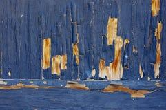 Blue paint peeling off wood. Bottom of old wood door with blue paint peeling off Royalty Free Stock Photos