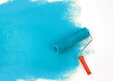 Blue paint roller Stock Photography