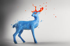 Blue paint sculpture magic deer with melting horns Stock Photo