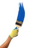 Blue paint splashing out of brush. Isolated on white background Royalty Free Stock Photo