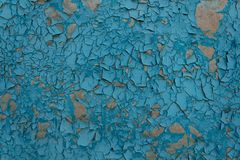 Blue paint on the surface peeled off, peeled off and cracked from time and natural elements stock photos