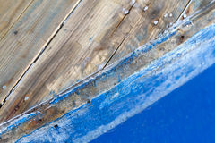 Blue paint on weathered wood Stock Photography