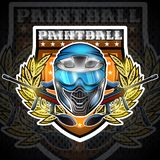 Blue paintball mask with guns in the center of wreath on shield. Sport logo for any team or tournament on black.  royalty free illustration