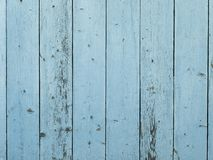 Blue painted barn wood wall. With distressed, peeling paint Stock Images