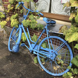 Blue painted bicycle Stock Image