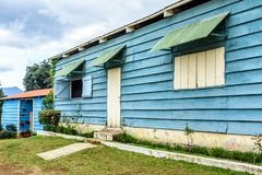 Blue painted clapboard or weatherboard siding on house exterior. House exterior with blue painted clapboard or weatherboard siding in Central America. Also known stock photo