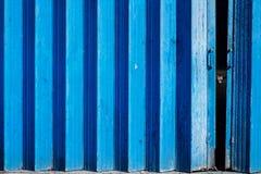 Blue painted concertina gates Royalty Free Stock Photos