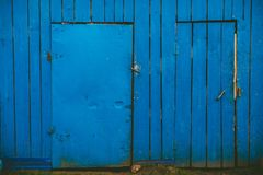 Blue wooden wall with two doors royalty free stock photography