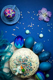 Blue painted eggs, easter cake, sugar hare, gingerbread, celebration table Stock Photos