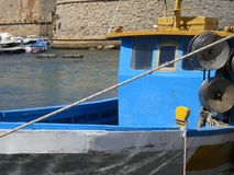 Blue painted fishingboat in the harbor of Gallipoli Italy. A blue painted fishingboat in the harbor of Gallipoli Italy royalty free stock photos