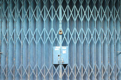 Blue painted foldable gate. A photo taken on a blue painted foldable gate with a padlock Royalty Free Stock Photos