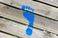 Blue Painted Footprint Stock Photos