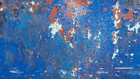 Blue painted metal background, with many cracks, peeling and flaking paint. Rusted texture royalty free stock images
