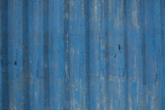 Blue painted metal sheet background. With cracked and faded paintwork, with the grain running vertically Stock Photos