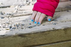 Blue painted nails on a young white girl. Blue painted nails close up still on a young white girl stock images