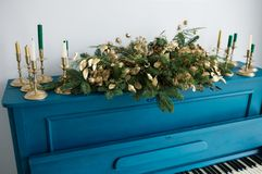 Blue painted old piano decorated with Christmas garland Stock Image