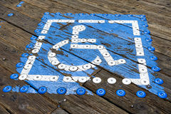 Blue painted parking space reserved for handicapped Royalty Free Stock Image