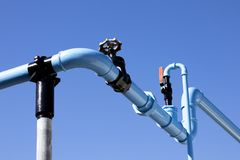 Blue painted pipework. Supplying compressed air to manufacturing buildings stock images