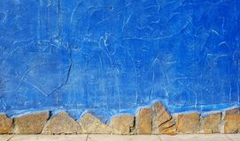 Blue painted plaster on a concrete wall stock images
