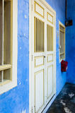 Blue painted shophouse facade. Blue painted Chinese shophouse facade in historic George Town, Penang, Malaysia Stock Photo
