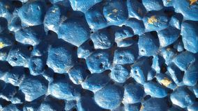 Blue stones background. Little stones texture. Blue painted stone background. Backdrop with little stones Stock Photography