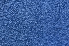 Blue painted stucco wall. Stock Photo