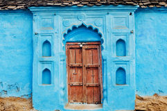 Blue painted traditional house with closed wooden door in India Royalty Free Stock Photography