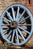 Blue painted wagon wheel royalty free stock photos