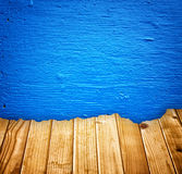 Blue painted wall and broken wood planks effect Stock Photos