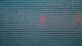 Blue painted Wall. I saw this car parking space where one of the perimeter walls are painted blue and the other wall is red. The day was sunny when I took this Royalty Free Stock Photo