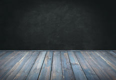 Blue painted wood table with dark wall background. For your display Royalty Free Stock Images