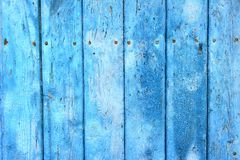 Blue Painted Wooden Boards. A closeup on wooden boards painted with blue paint, partially peeled off Royalty Free Stock Photo