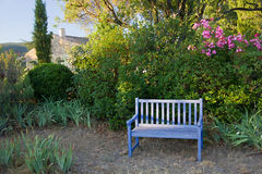 Blue painted wooden garden bench, Provence, France. Stock Photo