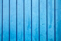 Blue painted wooden wall plank perpendicular to the frame as simple saturated blue oil paint timber wood background royalty free stock photos