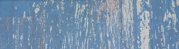 Blue painted wooden wall plank to the frame as simple peeling paint timber old grungy weathered wood surface texture background royalty free stock photo
