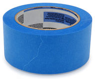 Blue Painters Tape. Roll of blue painters tape over white Stock Photography